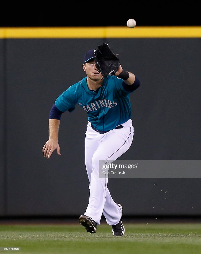 Center fielder Michael Saunders #55 of the Seattle Mariners catches a fly ball hit by Nick Markakis of the Baltimore Orioles in the sixth inning at Safeco Field on April 29, 2013 in Seattle, Washington.