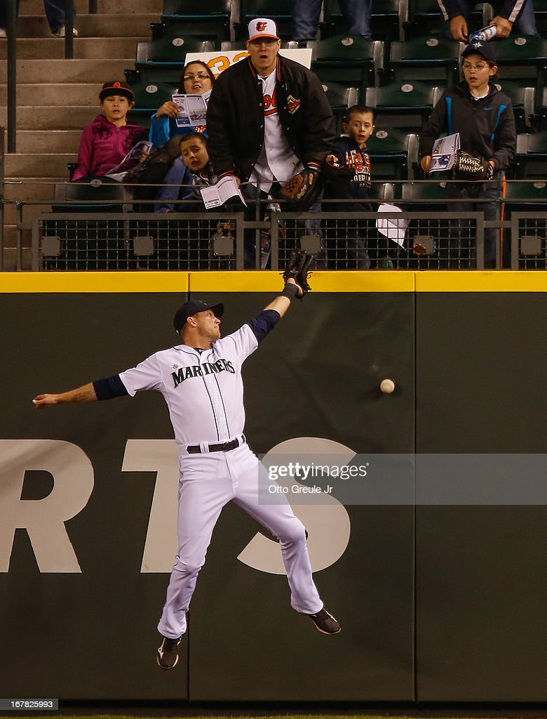 Center fielder Michael Saunders #55 of the Seattle Mariners misses a double by Ryan Flaherty #3 of the Baltimore Orioles in the sixth inning at Safeco Field on April 30, 2013 in Seattle, Washington.