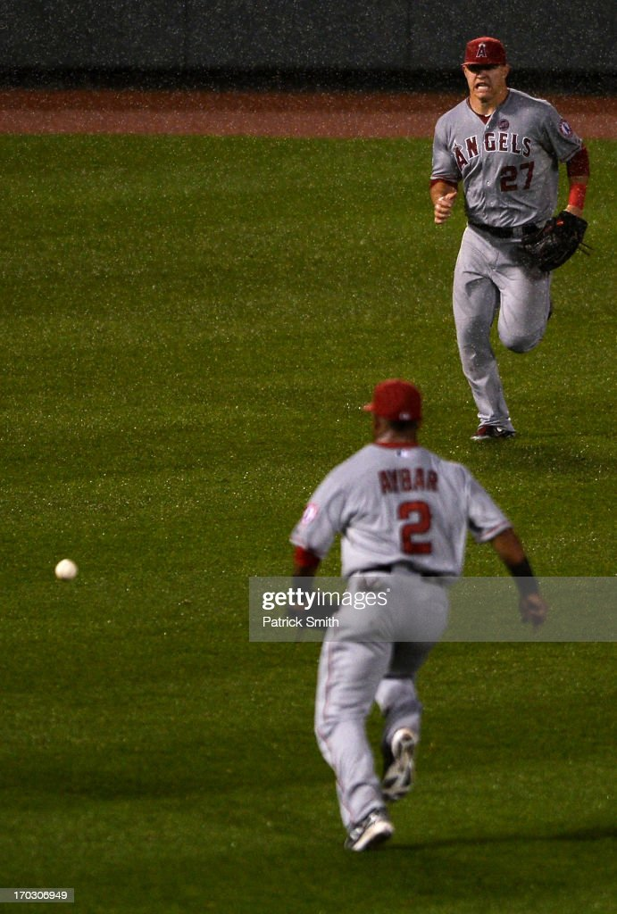 Center fielder <a gi-track='captionPersonalityLinkClicked' href=/galleries/search?phrase=Mike+Trout&family=editorial&specificpeople=7091306 ng-click='$event.stopPropagation()'>Mike Trout</a> #27 of the Los Angeles Angels of Anaheim and teammate shortstop <a gi-track='captionPersonalityLinkClicked' href=/galleries/search?phrase=Erick+Aybar&family=editorial&specificpeople=551376 ng-click='$event.stopPropagation()'>Erick Aybar</a> #2 cannot get to a Nick Markakis #21 of the Baltimore Orioles (not pictured) hit that scored a run for the Baltimore Orioles in the sixth inning at Oriole Park at Camden Yards on June 10, 2013 in Baltimore, Maryland.