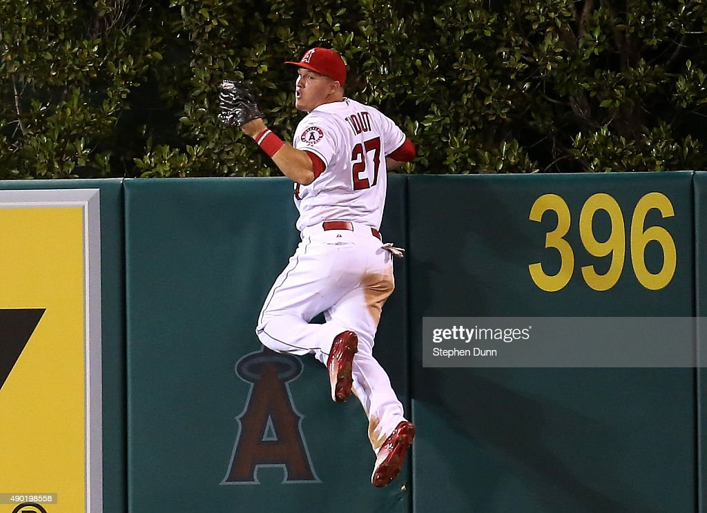 Center fielder Mike Trout of the Los Angeles Angels of Anaheim reacts after jumping at the wall and making the catch to take a home away from Jesus...