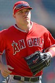 Center fielder Mike Trout of the Los Angeles Angels of Anaheim runs off the field to the dugout after the third out of the inning in the game against...