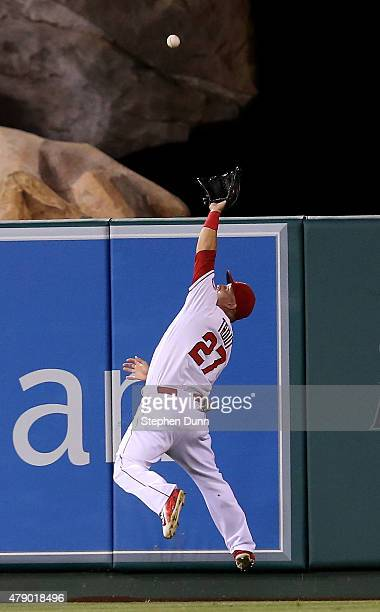Center fielder Mike Trout the Los Angeles Angels of Anaheim makes a leaping catch as he runs down a ball hit by Chris Young of the New York Yankees...