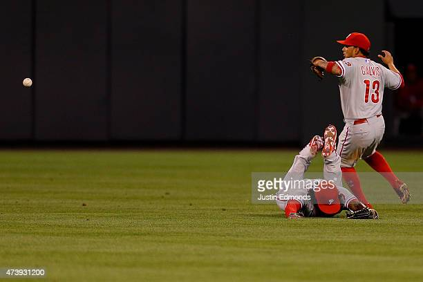Center fielder Odubel Herrera of the Philadelphia Phillies face plants into the ground after coming up short on a double off the bat of Drew Stubbs...