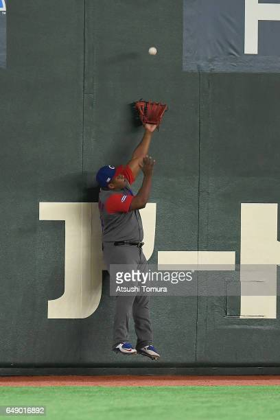 Center fielder Roel Santos of Cuba misses to catch allowing Norichika Aoki of Japan to make a double in the first inning of the World Baseball...