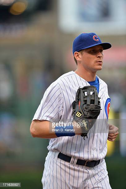 Center fielder Ryan Sweeney of the Chicago Cubs runs off the field against the Houston Astros at Wrigley Field on June 21 2013 in Chicago Illinois...