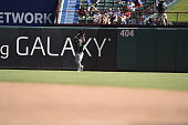 Center fielder Sam Fuld of the Oakland Athletics fields his position as he catches a fly ball in the game against the Texas Rangers at Globe Life...