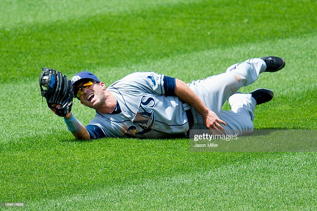 Center fielder <a gi-track='captionPersonalityLinkClicked' href=/galleries/search?phrase=Sam+Fuld&family=editorial&specificpeople=4505687 ng-click='$event.stopPropagation()'>Sam Fuld</a> #5 of the Tampa Bay Rays catches a fly ball hit by Drew Stubbs #11 of the Cleveland Indians to end the fourth inning at Progressive Field on June 2, 2013 in Cleveland, Ohio.