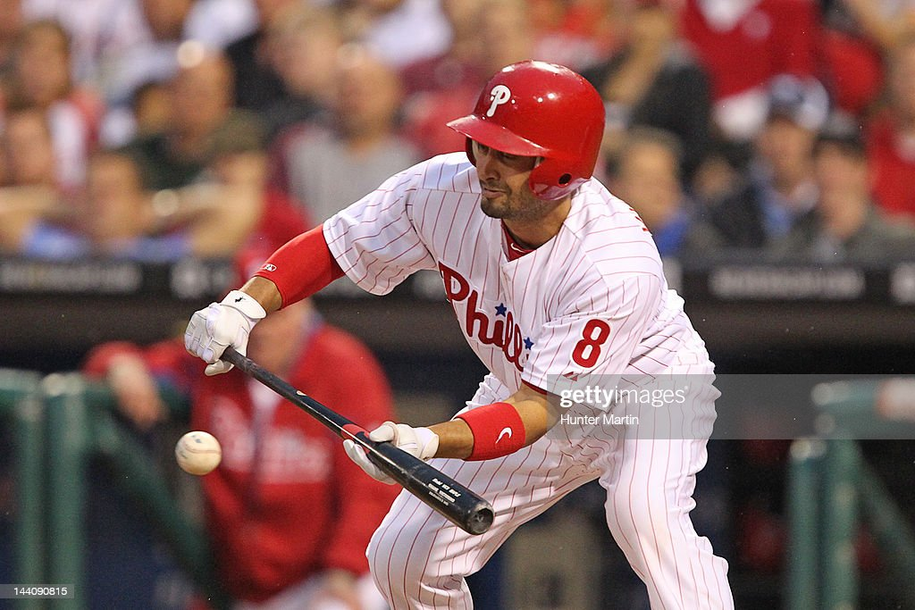 Center fielder <a gi-track='captionPersonalityLinkClicked' href=/galleries/search?phrase=Shane+Victorino&family=editorial&specificpeople=576251 ng-click='$event.stopPropagation()'>Shane Victorino</a> #8 of the Philadelphia Phillies bunts during a game against the New York Mets at Citizens Bank Park on May 9, 2012 in Philadelphia, Pennsylvania.