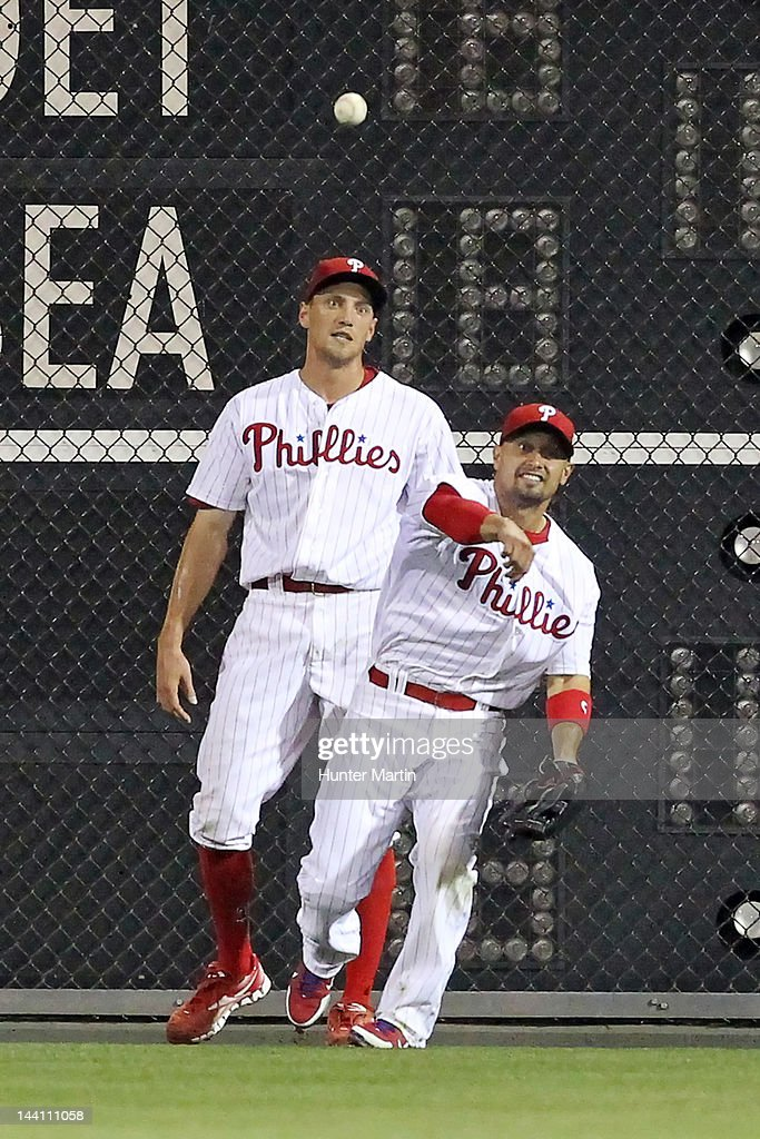 Center fielder <a gi-track='captionPersonalityLinkClicked' href=/galleries/search?phrase=Shane+Victorino&family=editorial&specificpeople=576251 ng-click='$event.stopPropagation()'>Shane Victorino</a> #8 of the Philadelphia Phillies makes a throw from the outfield as right fielder <a gi-track='captionPersonalityLinkClicked' href=/galleries/search?phrase=Hunter+Pence&family=editorial&specificpeople=757341 ng-click='$event.stopPropagation()'>Hunter Pence</a> #3 looks on during a game against the New York Mets at Citizens Bank Park on May 9, 2012 in Philadelphia, Pennsylvania. The Mets won 10-6.