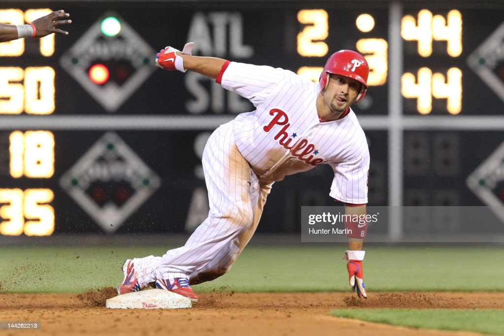 Center fielder <a gi-track='captionPersonalityLinkClicked' href=/galleries/search?phrase=Shane+Victorino&family=editorial&specificpeople=576251 ng-click='$event.stopPropagation()'>Shane Victorino</a> #8 of the Philadelphia Phillies slides into second base during a game against the San Diego Padres at Citizens Bank Park on May 12, 2012 in Philadelphia, Pennsylvania.