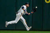Center fielder Shawn O'Malley of the Seattle Mariners catches a fly ball off the bat of David Freese of the Los Angeles Angels of Anaheim in the...