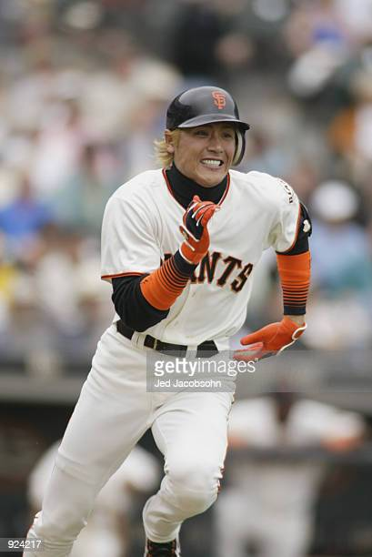 Center fielder Tsuyoshi Shinjo of the San Francisco Giants runs to first base during the MLB game against the San Diego Padres on June 27 2002 at...