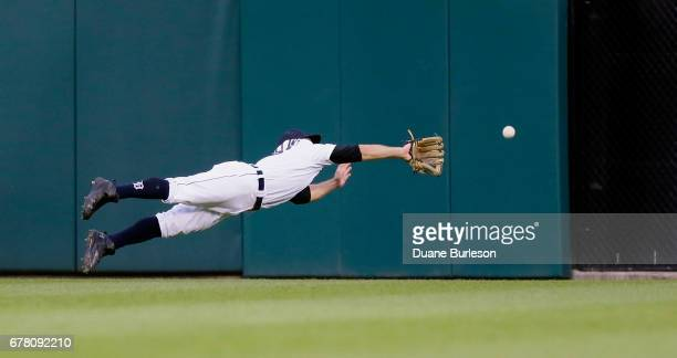 Center fielder Tyler Collins of the Detroit Tigers makes a diving attempt on a triple hit by Jose Ramirez of the Cleveland Indians during the fourth...