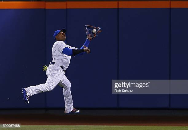 Center fielder Yoenis Cespedes of the New York Mets reaches back to make a catch on a ball hit by Peter Bourjos during the eighth inning of a game at...
