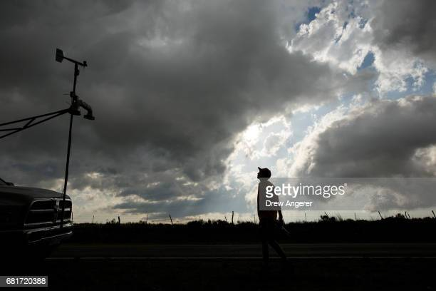 Center for Severe Weather Research intern Hunter Anderson views cloud activity at the end of a severe thunderstorm May 10 2017 in Vinson Texas...