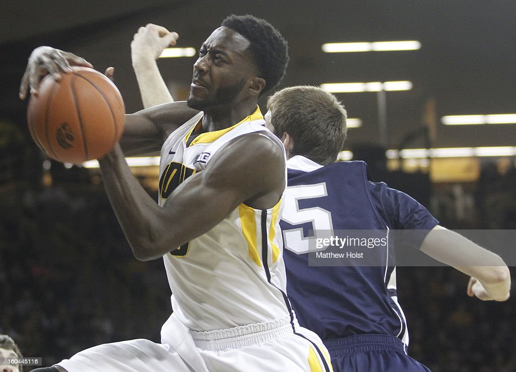 Center Gabriel Olaseni #0 of the Iowa Hawkeyes grabs a rebound during the first half in front of forward Donovan Jack #5 of the Penn State Nittany Lions on January 31, 2013 at Carver-Hawkeye Arena in Iowa City, Iowa.