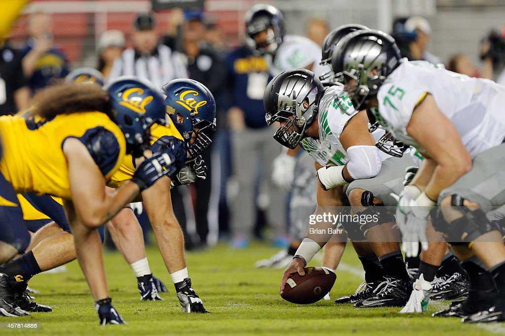 Center Hroniss Grasu #55 of the Oregon Ducks snap the ball against the California Bears in the first quarter on October 24, 2014 at Levi's Stadium in Santa Clara, California.