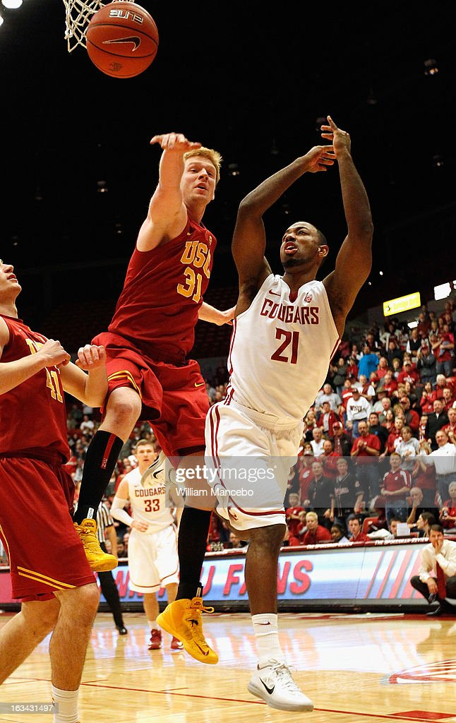 Center James Blasczyk #31 of the USC Trojans blocks the shot of Dominic Ballard #21 of the Washington State Cougars during the game at Beasley Coliseum on March 9, 2013 in Pullman, Washington.