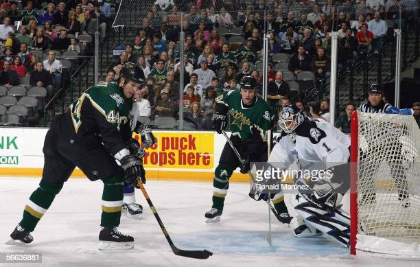 Center Jason Arnott of the Dallas Stars takes a shot against Sean Burke of the Tampa Bay Lightning on January 20 2006 at the American Airlines Center...