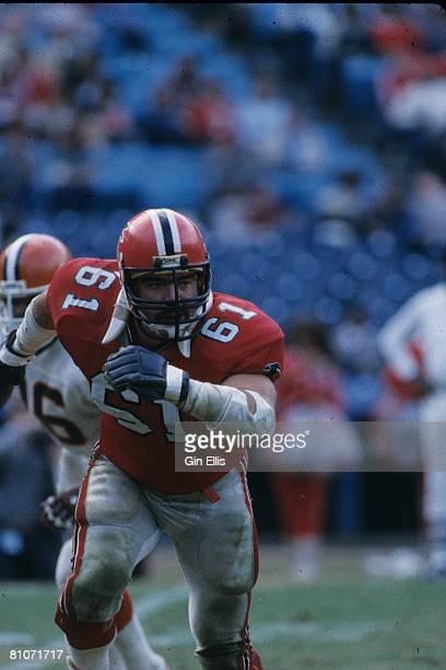 Center John Scully of the Atlanta Falcons runs upfield to block against the Cleveland Browns in Atlanta FultonCounty Stadium on November 18 1984 in...