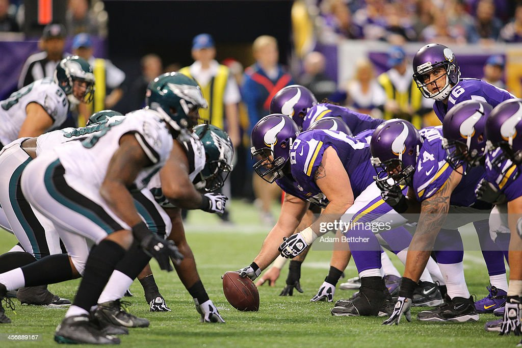 Center John Sullivan #65 of the Minnesota Vikings prepares to snap the ball to <a gi-track='captionPersonalityLinkClicked' href=/galleries/search?phrase=Matt+Cassel&family=editorial&specificpeople=567575 ng-click='$event.stopPropagation()'>Matt Cassel</a> #16 during a game against the Philadelphia Eagles on December 15, 2013 at Mall of America Field at the Hubert H. Humphrey Metrodome in Minneapolis, Minnesota.