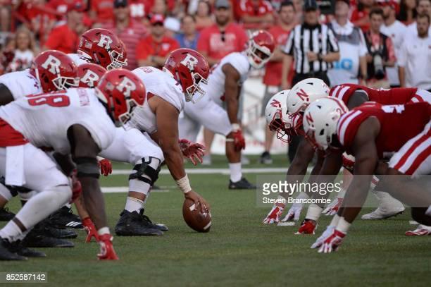Center Jonah Jackson of the Rutgers Scarlet Knights snaps against the Nebraska Cornhuskers at Memorial Stadium on September 23 2017 in Lincoln...
