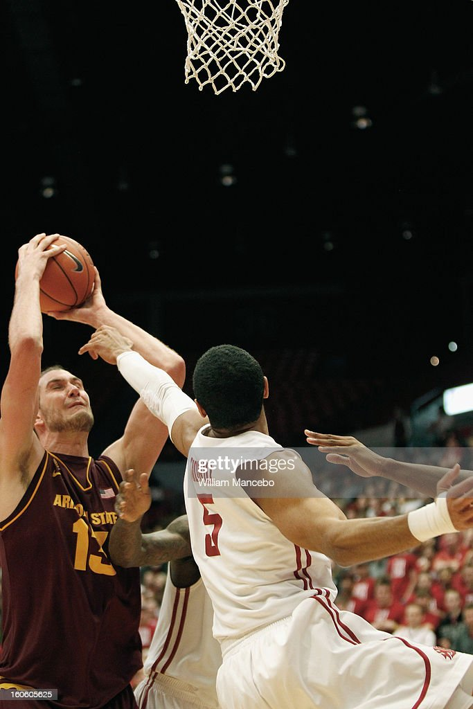 Center Jordan Bachynski #13 of the Arizona State Sun Devils attempts to shoot a goal against guard Will Diiorio #5 of the Washington State Cougars during the game at Beasley Coliseum on January 31, 2013 in Pullman, Washington.