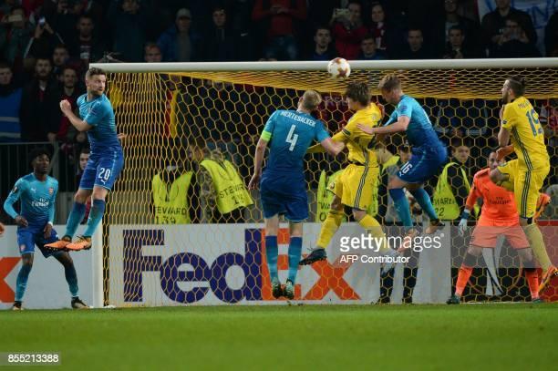 Arsenal's defender from Germany Per Mertesacker BATE Borisov's midfielder from Belarus Dmitri Baha and Arsenal's defender from England Rob Holding...