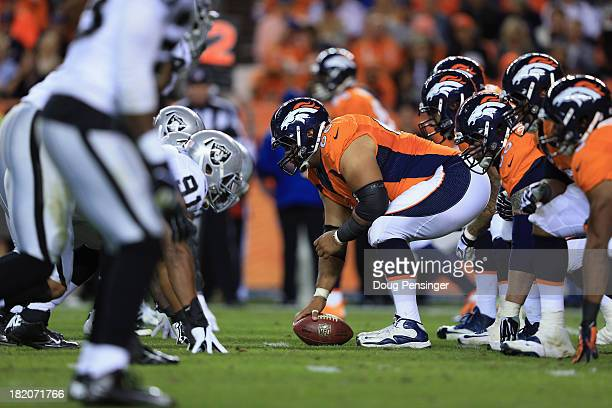 Center Manny Ramirez of the Denver Broncos prepares to snap the ball as the Broncos offensive line faces the Oakland Raiders defensive line at Sports...