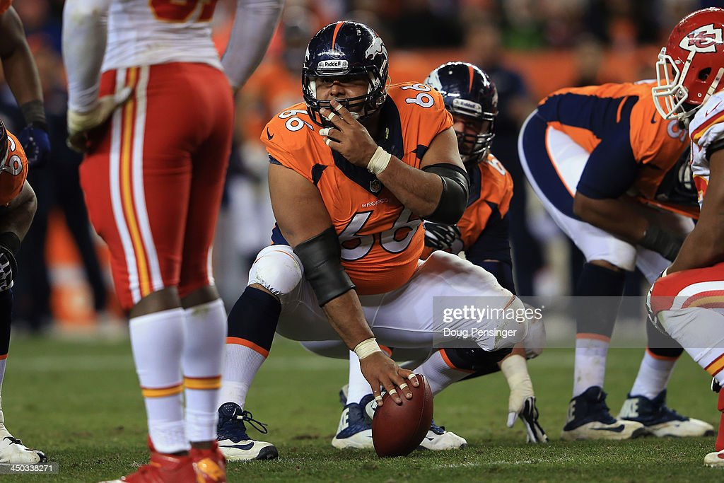 Center Manny Ramirez #66 of the Denver Broncos prepares to snap the ball against the Kansas City Chiefs at Sports Authority Field at Mile High on November 17, 2013 in Denver, Colorado. The Broncos defeated the Chiefs 27-17.
