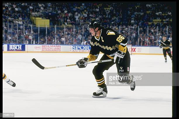 Center Mario Lemieux of the Pittsburgh Penguins skates down the ice during a game Mandatory Credit Rick Stewart /Allsport
