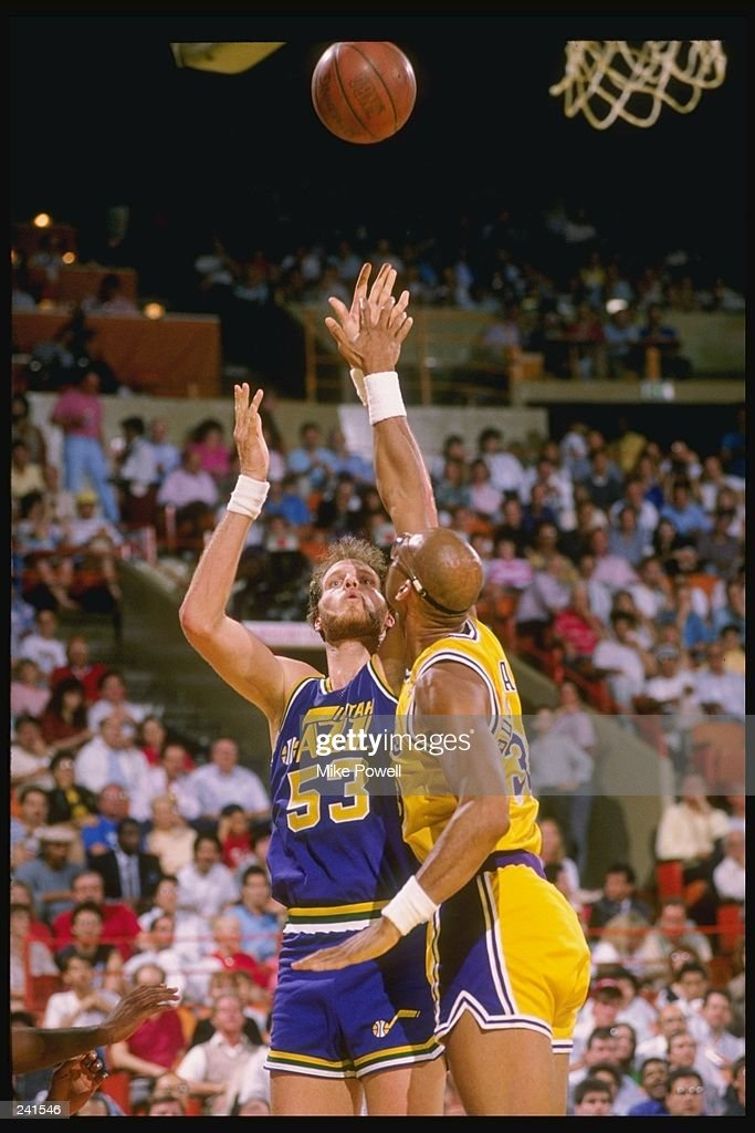 Center Mark Eaton of the Utah Jazz (left) in action against guard Kareem Abdul-Jabbar of the Los Angeles Lakers during a game at the Great Western Forum in Inglewood, California. Mandatory Credit: Mike Powell /Allsport
