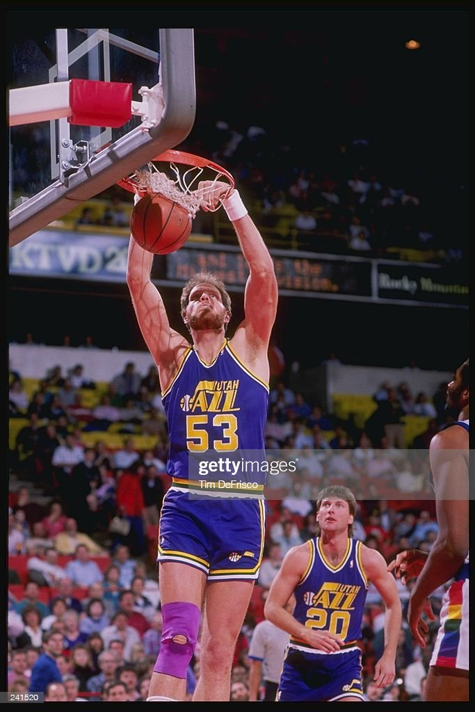 Center Mark Eaton of the Utah Jazz slam dunks as teammate guard Bobby Hansen (right) looks on during a game against the Denver Nuggets at McNichols Arena in Denver, Colorado. Mandatory Credit: Tim de Frisco /Allsport