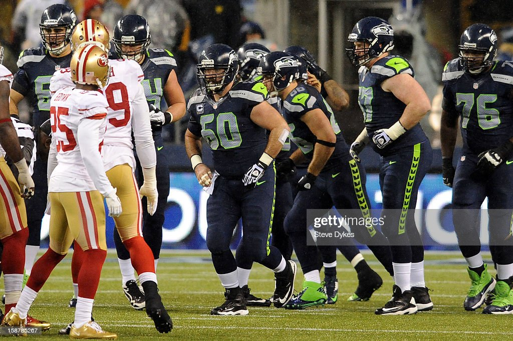Center Max Unger #60 of the Seattle Seahawks braks the huddle during the first quarter of the game against the San Francisco 49ers at CenturyLink Field on December 23, 2012 in Seattle,Wa.