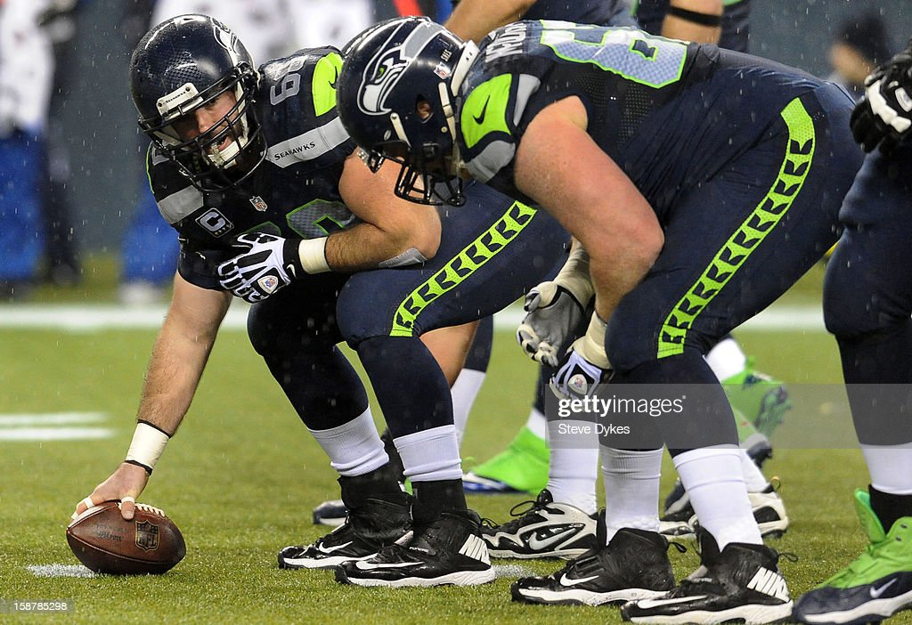 Center Max Unger #60 of the Seattle Seahawks gets ready to snap the ball during the first quarter of the game against the San Francisco 49ers at CenturyLink Field on December 23, 2012 in Seattle,Wa.