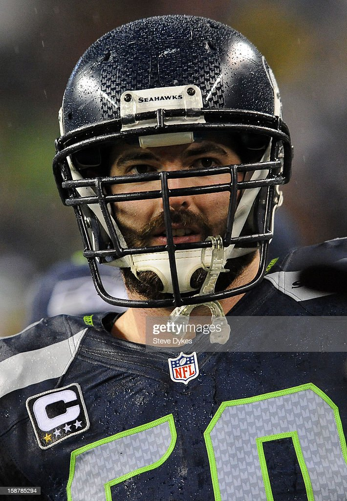 Center Max Unger #60 of the Seattle Seahawks looks on from the bench during the first quarter of the game against the San Francisco 49ers at CenturyLink Field on December 23, 2012 in Seattle,Wa.