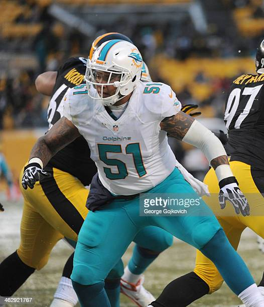 Center Mike Pouncey of the Miami Dolphins blocks during a game against the Pittsburgh Steelers at Heinz Field on December 8 2013 in Pittsburgh...