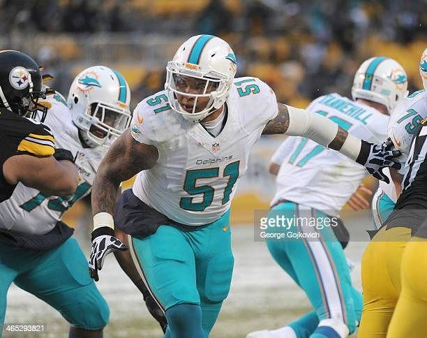 Center Mike Pouncey of the Miami Dolphins looks to block during a game against the Pittsburgh Steelers at Heinz Field on December 8 2013 in...