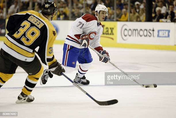 Center Mike Ribeiro of the Montreal Canadiens is pressured by center Travis Green of the Boston Bruins during the game at the Fleet Center on April 7...