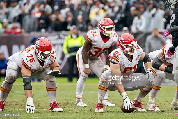 Center Mitch Morse and right guard Laurent DuvernayTardif of the Kansas City Chiefs prepare to snap the ball against the Oakland Raiders in the...