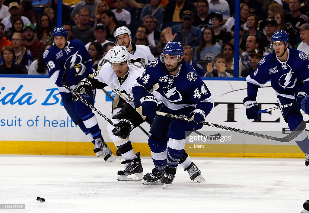 Center Nate Thompson #44 of the Tampa Bay Lightning battles right wing <a gi-track='captionPersonalityLinkClicked' href=/galleries/search?phrase=Jarome+Iginla&family=editorial&specificpeople=201792 ng-click='$event.stopPropagation()'>Jarome Iginla</a> #12 of the Pittsburgh Penguins for the puck during the game at the Tampa Bay Times Forum on April 11, 2013 in Tampa, Florida.