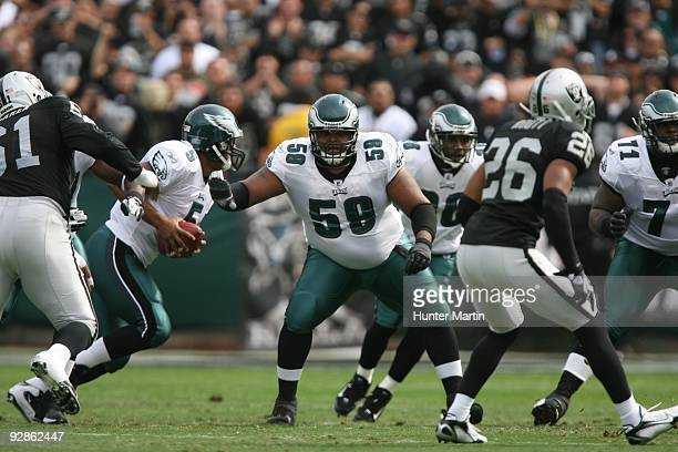 Center Nick Cole of the Philadelphia Eagles blocks during a game against the Oakland Raiders on October 18 2009 at OaklandAlameda County Coliseum in...