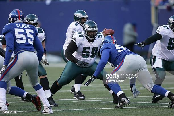 Center Nick Cole of the Philadelphia Eagles pass blocks during the NFC Divisional Playoff game against the New York Giants on January 11 2009 at...
