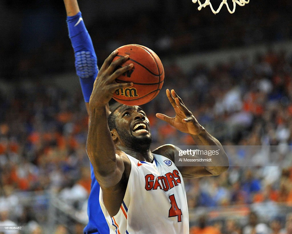 Center Patric Young #4 of the Florida Gators grabs a rebound against the Kentucky Wildcats February 12, 2013 at Stephen C. O'Connell Center in Gainesville, Florida. Florida won 69 - 52.