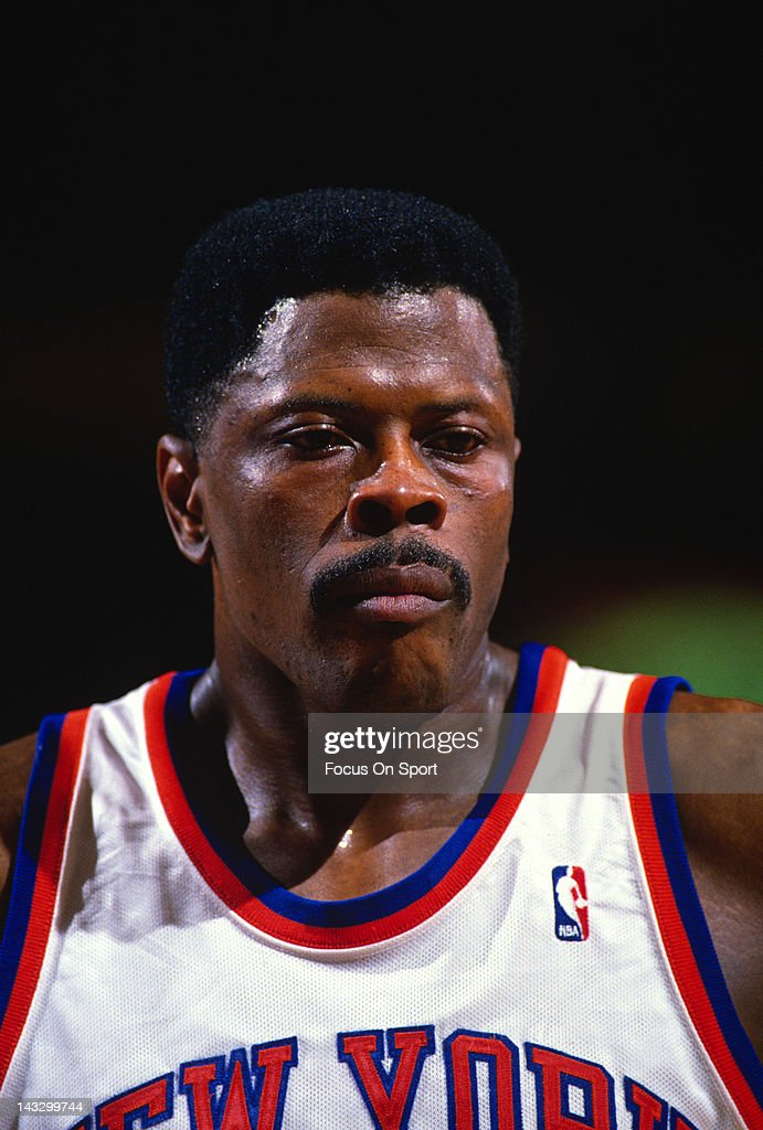 Center Patrick Ewing of the New York Knicks looks on against the Cleveland Cavaliers during an NBA basketball game circa 1988 at Madison Square...