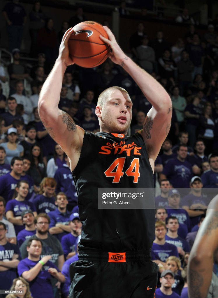 Center Philip Jurick #44 of the Oklahoma State Cowboys grabs a defensive rebound against the Kansas State Wildcats during the second half on January 5, 2013 at Bramlage Coliseum in Manhattan, Kansas.