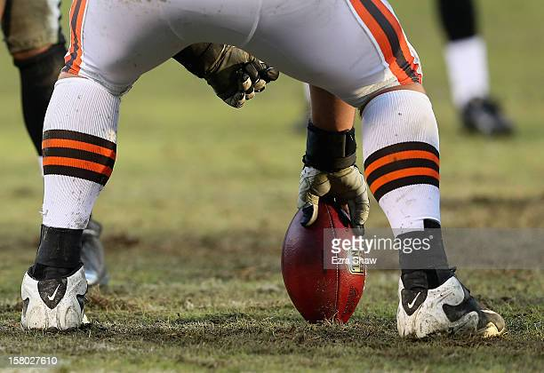 A center prepares to hike the NFL ball during the Cleveland Browns game against the Oakland Raiders at Oco Coliseum on December 2 2012 in Oakland...