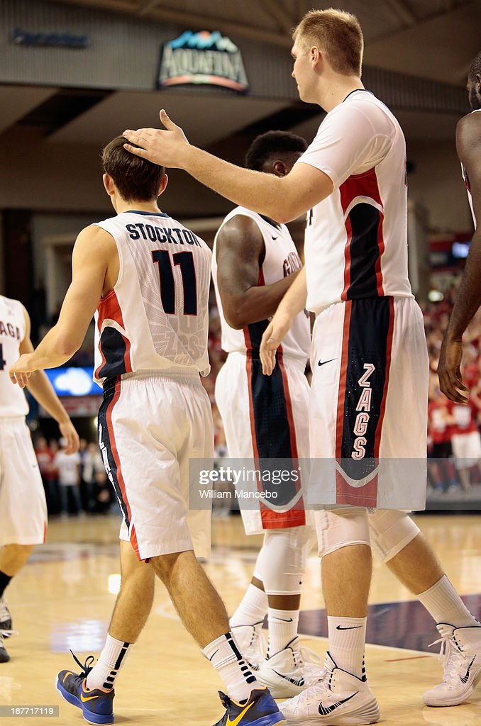 Center Przemek Karnowski #24 of the Gonzaga Bulldogs congratulates teammate David Stockton #11 with a pat on the head after Stockton's goal during the second half of the game against the Colorado State Rams at McCarthey Athletic Center on November 11, 2013 in Spokane, Washington.