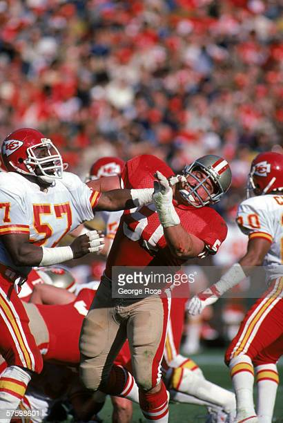Center Randy Cross of the San Francisco 49ers battles against Kansas City Chiefs linebacker Jerry Blanton at Candlestick Park on November 17 1985 in...