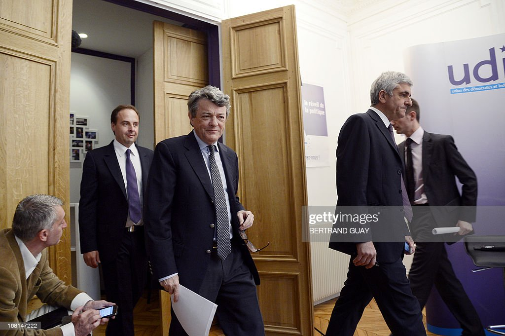 UDI center right wing French party's president Jean-Louis Borloo (C) arrives to give a press conference flanked by his Nouveau Centre (NC) center right party's counterpart Herve Morin (R) and UDI spokesman Jean-Christophe Lagarde (L) on May 6, 2013, focused on the first anniversary of the Francois Hollande's presidency.
